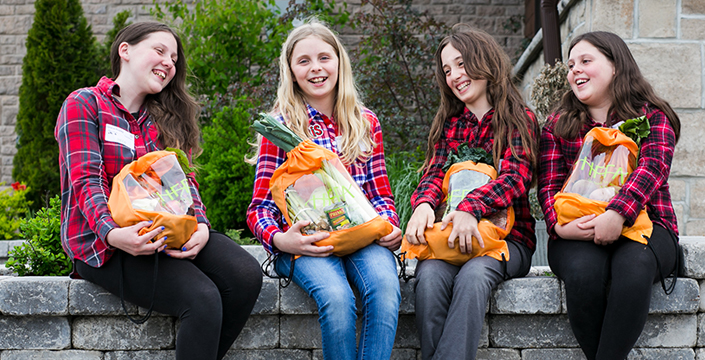 Happy students with their HFFA Farm to School Food bags filled with fresh, local food!