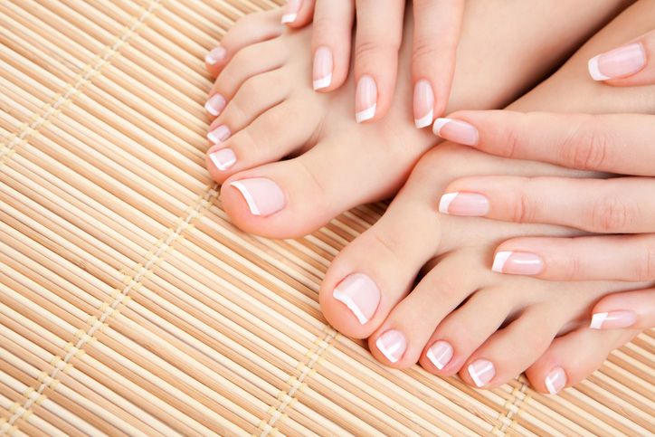 Toes and fingers with french manicure