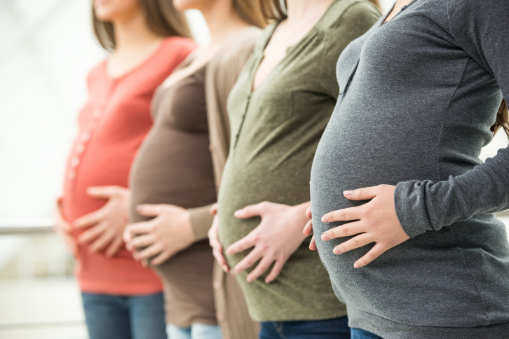 Pregnant women holding bellies
