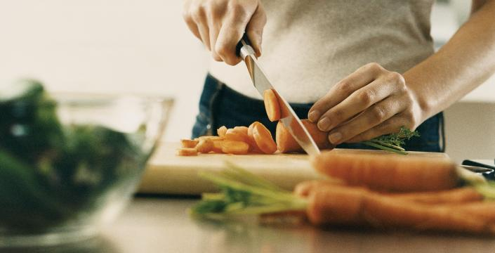 Vegetables being chopped on cutting board