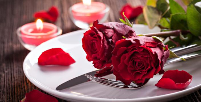 Red Roses resting on a white plate