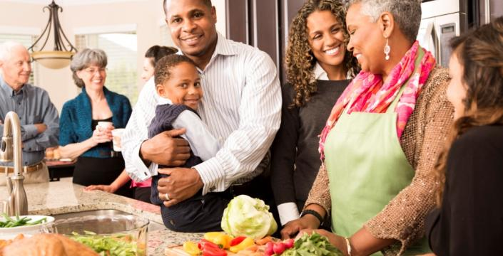 Multigenerational family cooking a holiday meal together