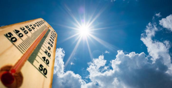 Thermometer pointing up towards the sun and sky