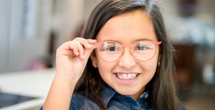 Junior Kindergarten girl showing off her new glasses