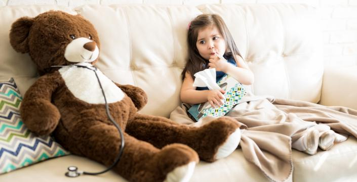 A sick toddler girl with her teddy bear